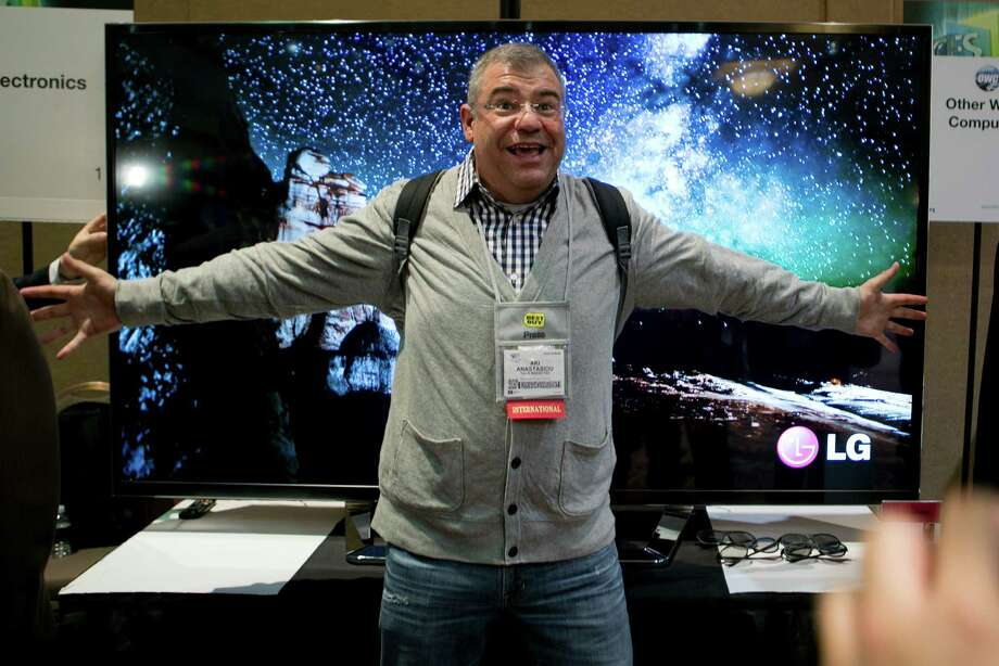 Aki Anastasiou stands in front of an LG Electronics Inc. Ultra HD Cinema 3D television during a press event prior to the 2013 International Consumer Electronics Show in Las Vegas on Sunday. Photo: Andrew Harrer, Bloomberg / © 2013 Bloomberg Finance LP