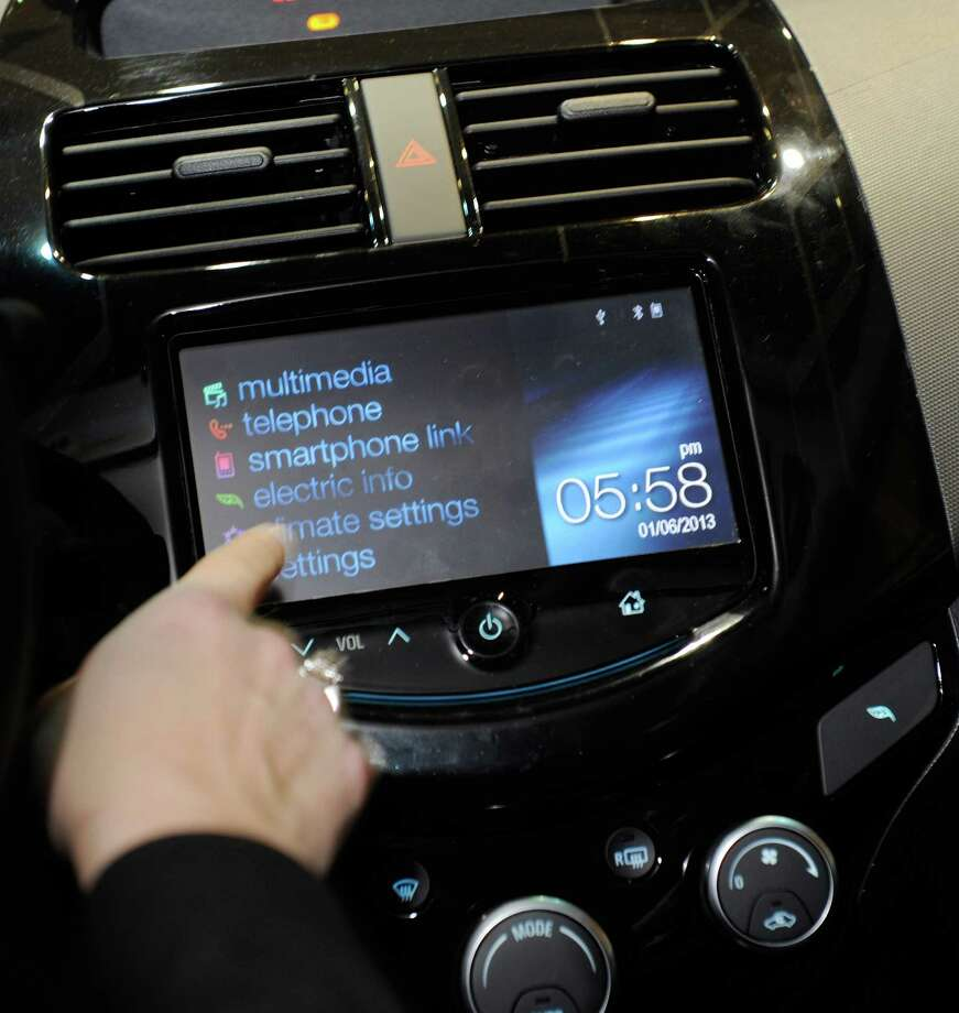 A MyLink menu is displayed inside a Chevrolet Spark electric car during a press event. Photo: David Becker, Getty Images / 2013 Getty Images