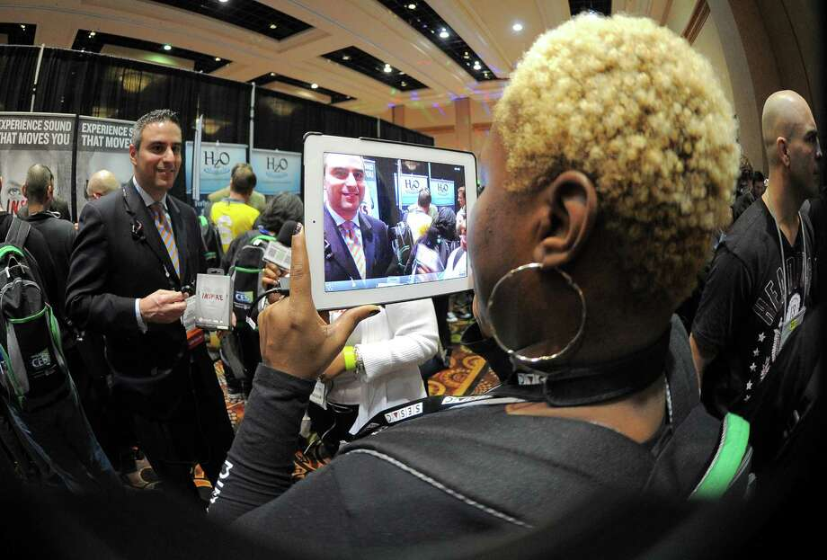 "A journalists makes an interview with an iPad on Sunday during the opening event ''CES Unveiled."" Photo: JOE KLAMAR, AFP/Getty Images / AFP"