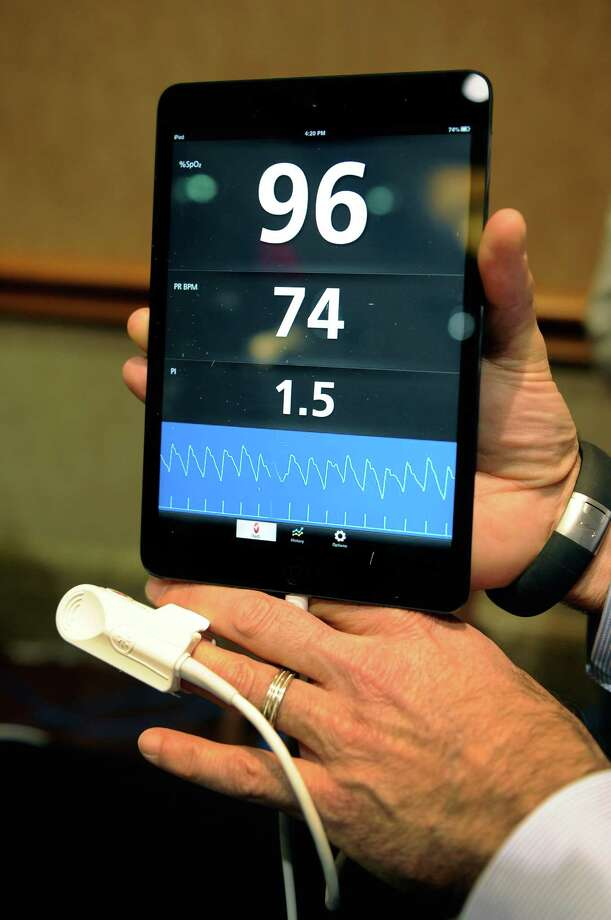 An iSpO2 pulse oximeter is on display. The $249 personal health monitor attaches to the user's mobile device and can record, save and transmit vital statistics. Photo: David Becker, Getty Images / 2013 Getty Images