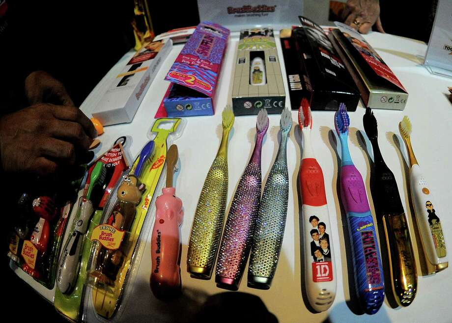 Brushbuddies, talking singing and popping-up tooth brushes, are displayed Sunday. Photo: JOE KLAMAR, AFP/Getty Images / AFP