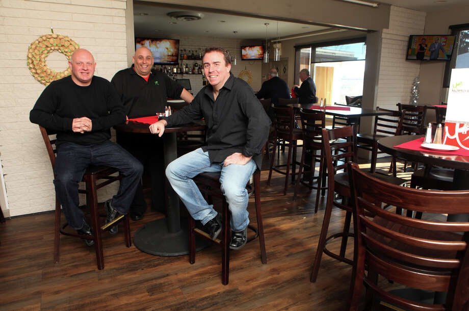 Co owners, Anthony Fry, left, and Drew Pickering, right, and chef Dino DiGirolamo sit in the newly designed dinning room and bar of Molto Bene in Ansonia on Monday, January 7, 2012. Photo: BK Angeletti, B.K. Angeletti / Connecticut Post freelance B.K. Angeletti