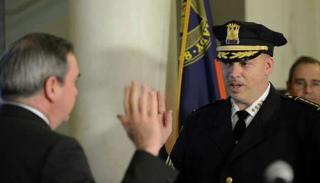 Schenectady's new police chief, Brian Kilcullen, is sworn into office by Mayor Gary McCarthy during a ceremony Monday morning at City Hall. (Skip Dickstein / Times Union) Photo: SKIP DICKSTEIN / 00020667A