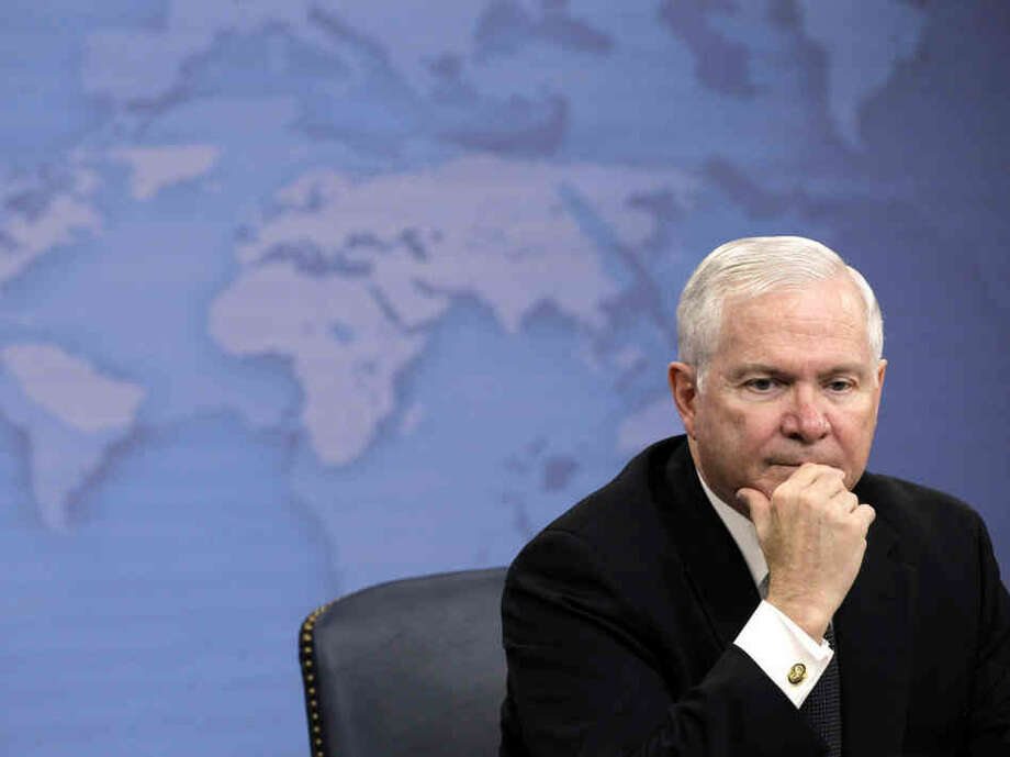 Defense Secretary Robert Gates listens to a reporter's question during a news briefing about gays in the military Tuesday at the Pentagon. (Charles Dharapak / AP Photo)