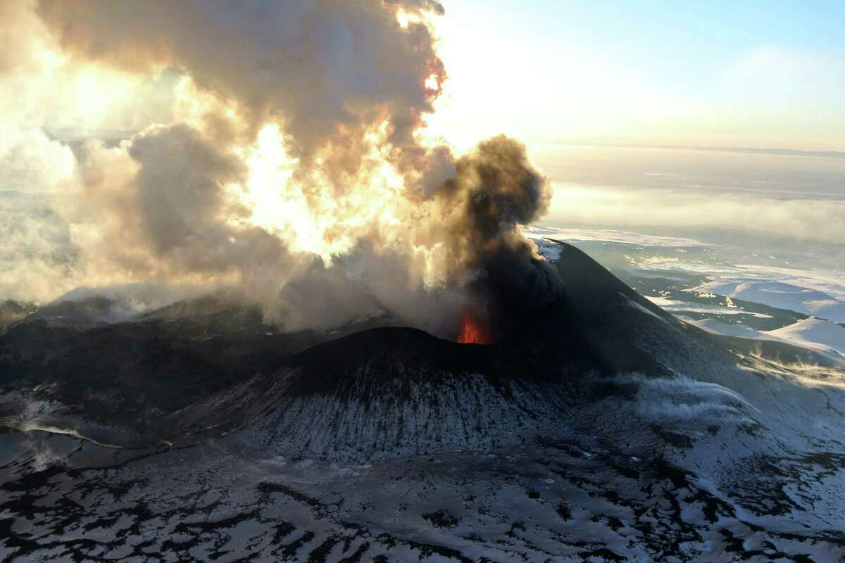 In this photo taken on Sunday, the Plosky Tolbachnik volcano erupts in Russia's Far Eastern Kamchatka Peninsula. A Russian volcano which started erupting last week has continued to spew ash and smoke into the air. The Plosky Tolbachik volcano, in the Kamchatka Peninsula, last erupted in 1976.