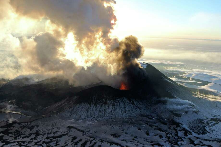 In this photo taken on Sunday, the Plosky Tolbachnik volcano erupts in Russia's Far Eastern Kamchatka Peninsula. A Russian volcano which started erupting last week has continued to spew ash and smoke into the air. The Plosky Tolbachik volcano, in the Kamchatka Peninsula, last erupted in 1976. Photo: AP