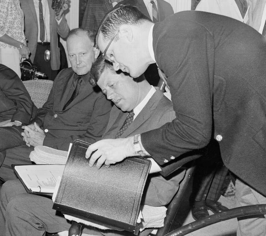 President John F. Kennedy meets with officials from the Department of the Treasury and members of his staff at the winter White House in Palm Beach, Fla., Dec. 26, 1962, regarding his 1963 tax cut proposal.  Left to right: Secretary of the Treasury Douglas Dillon; Pres. Kennedy; and presidential council advisor Theodore Sorensen.  (William J. Smith / AP Photo) Photo: William J. Smith, ASSOCIATED PRESS / AP1962