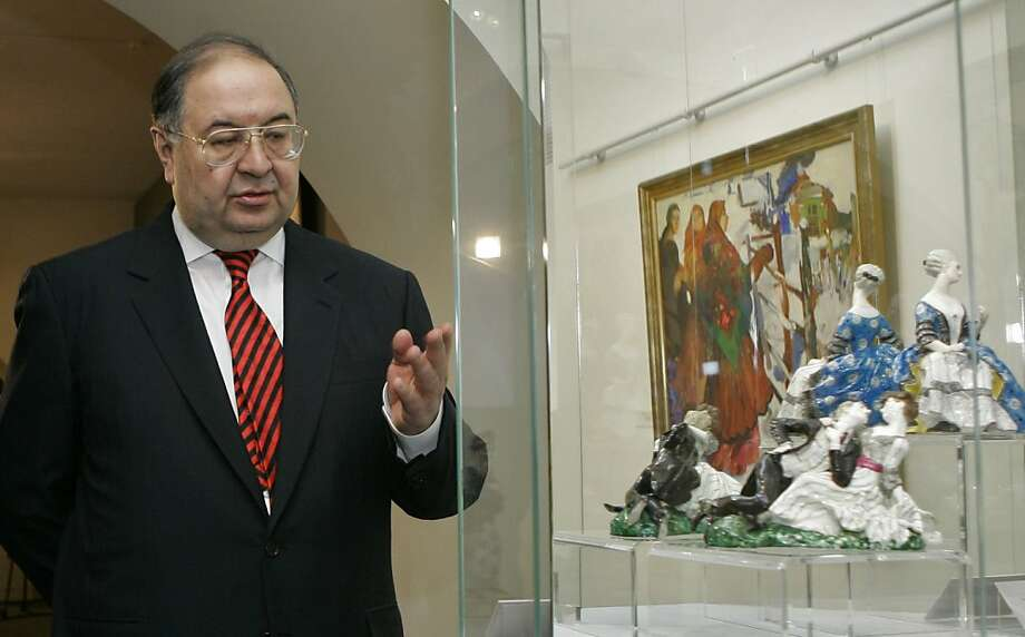 Russian billionaire Alisher Usmanov with art from the collection of late cellist Mstislav Rostropovich and his wife, Galina Vishnevskaya, in St. Petersburg. Photo: Dmitry Lovetsky, Associated Press
