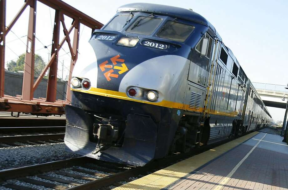 In this file photo, a Capitol Corridor train pulls up to the Hayward station. A Amtrak train hit a car this morning in Fremont that drove around closed gates, injuring the drive and passenger in the vehicle. Photo: Michael Maloney, The Chronicle