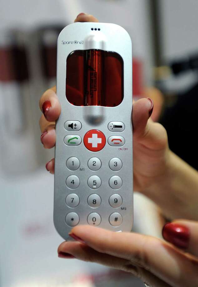 A SpareOne battery-powered emergency phone is displayed during a 2013 Consumer Electronics Show preview at the Mandalay Bay Convention Center on January 7, 2013 in Las Vegas. Photo: David Becker, Getty Images / 2013 Getty Images
