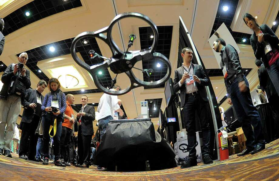 French company Parrot shows its automatic 4 rotor flying drones during a 2013 Consumer Electronics Show preview at the Mandalay Bay Convention Center on Sunday, January 6, 2013 in Las Vegas. Photo: JOE KLAMAR, AFP/Getty Images / 2013 AFP