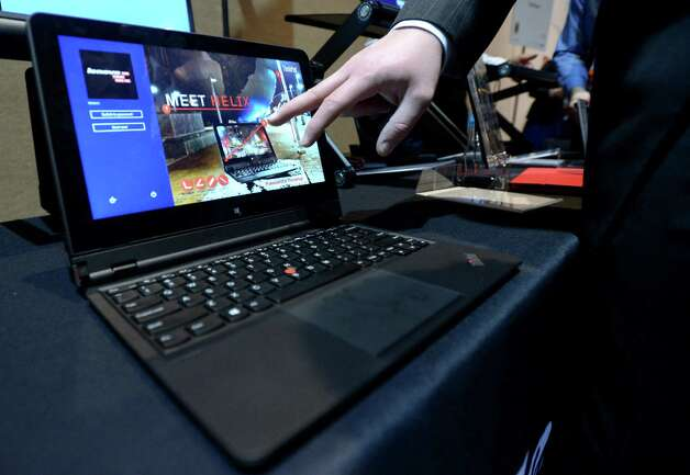 Lenovo introduces its new tablet/laptop Thinkpad Helix during a 2013 Consumer Electronics Show preview at the Mandalay Bay Convention Center on Sunday, January 6, 2013 in Las Vegas. Photo: JOE KLAMAR, AFP/Getty Images / 2013 AFP