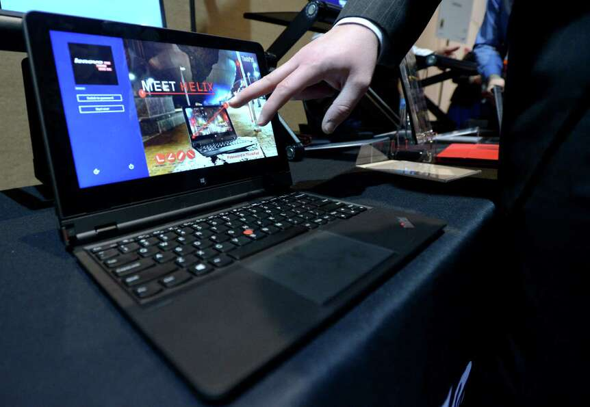 Lenovo introduces its new tablet/laptop Thinkpad Helix during a 2013 Consumer Electronics Show previ