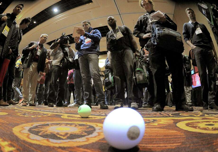 Sphero robot balls operated by iPad are shown during a 2013 Consumer Electronics Show preview at the Mandalay Bay Convention Center on Sunday, January 6, 2013 in Las Vegas. Photo: JOE KLAMAR, AFP/Getty Images / 2013 AFP