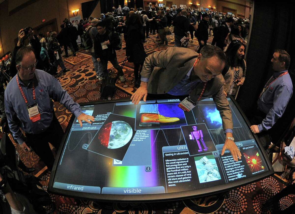 The 2013 Consumer Electronics Show is scheduled to start Tuesday in Las Vegas, showcasing the latest in high-tech gadgets. Here's a preview, starting with Diego Romeu of 3M Touch Systems showing an 84 inch touch table on Sunday, January 6.