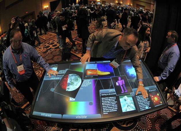 The 2013 Consumer Electronics Show is scheduled to start Tuesday in Las Vegas, showcasing the latest in high-tech gadgets. Here's a preview, starting with Diego Romeu of 3M Touch Systems showing an 84 inch touch table on Sunday, January 6. Photo: JOE KLAMAR, AFP/Getty Images / 2013 AFP