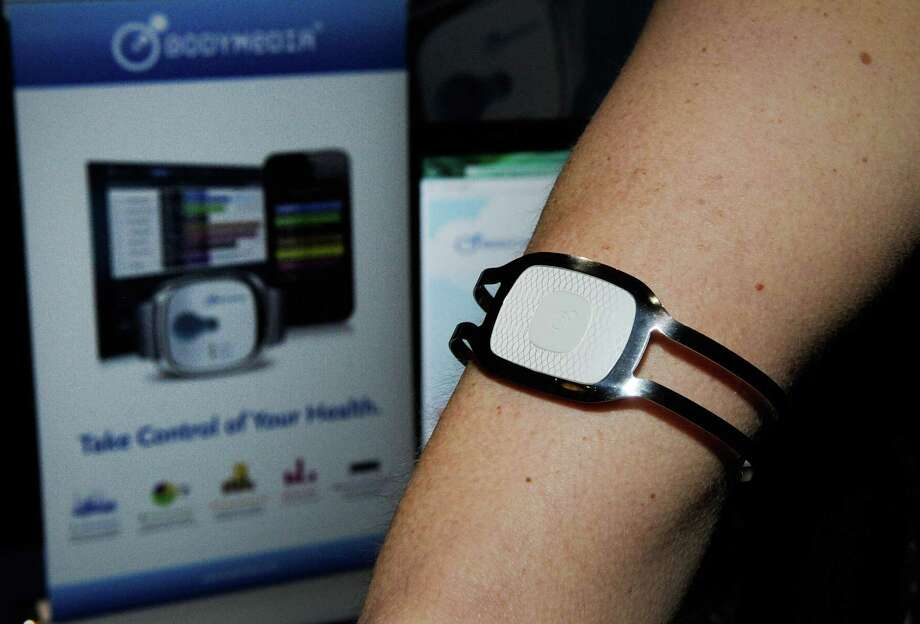 A Body Media monitor arm band is on display during a 2013 Consumer Electronics Show preview at the Mandalay Bay Convention Center on Sunday, January 6, 2013 in Las Vegas. Photo: David Becker, Getty Images / 2013 Getty Images