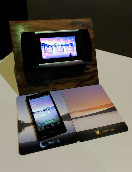 An Eversense electronic thermostat by Allure Energy is on display during a 2013 Consumer Electronics