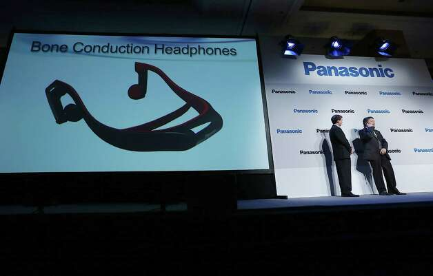 Shiro Kitajima, right, president of Panasonic Consumer Marketing Company of North America, demonstrates Bone Conduction Headphones at a Panasonic press conference during the 2013 Consumer Electronics Show preview at the Mandalay Bay Convention Center on January 7, 2013 in Las Vegas. Photo: Justin Sullivan, Getty Images / 2013 Getty Images