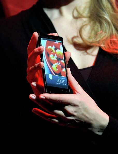 A Sharp Aquos Zeta SH-02E mobile phone using IGZO technology is displayed during a 2013 Consumer Ele