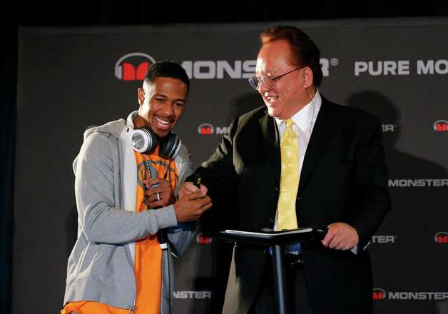 Recording artist Nick Cannon, left, shakes hands with Monster CEO Noel Lee during a news conference at the International Consumer Electronics Show in Las Vegas, Monday, Jan. 7, 2013. Photo: AP
