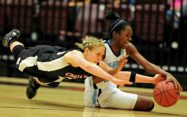 Johnson's Erica Sanders (right) and Churchill's Leslie Vorpahl (left) dive after a loose ball during the Jaguars 51-48 overtime victory over the Chargers last week. Photo: John Albright, For The North Central News / John Albright / www.johnalbrightphoto.com