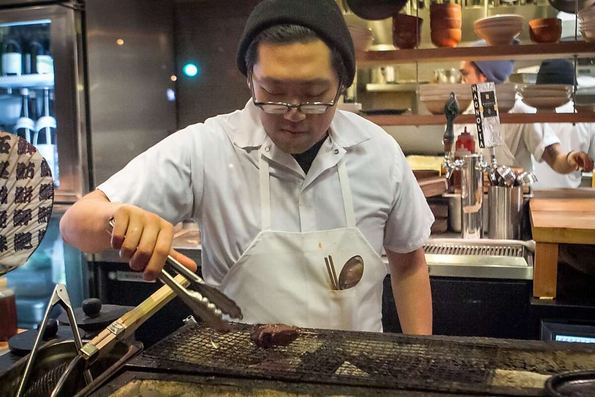 Chef Daniel Lim cooks a piece of beef on the grill at Namu Gaji in San Francisco, Calif. on Thursday, January 3rd, 2013.