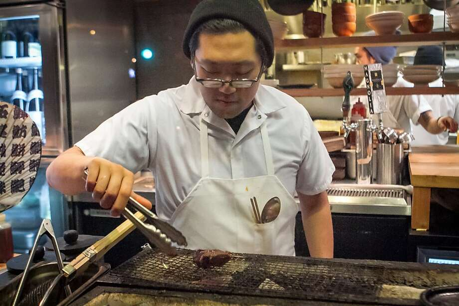 Sous chef Daniel Lim cooks a piece of beef on the grill at Namu Gaji in San Francisco. Photo: John Storey, Special To The Chronicle