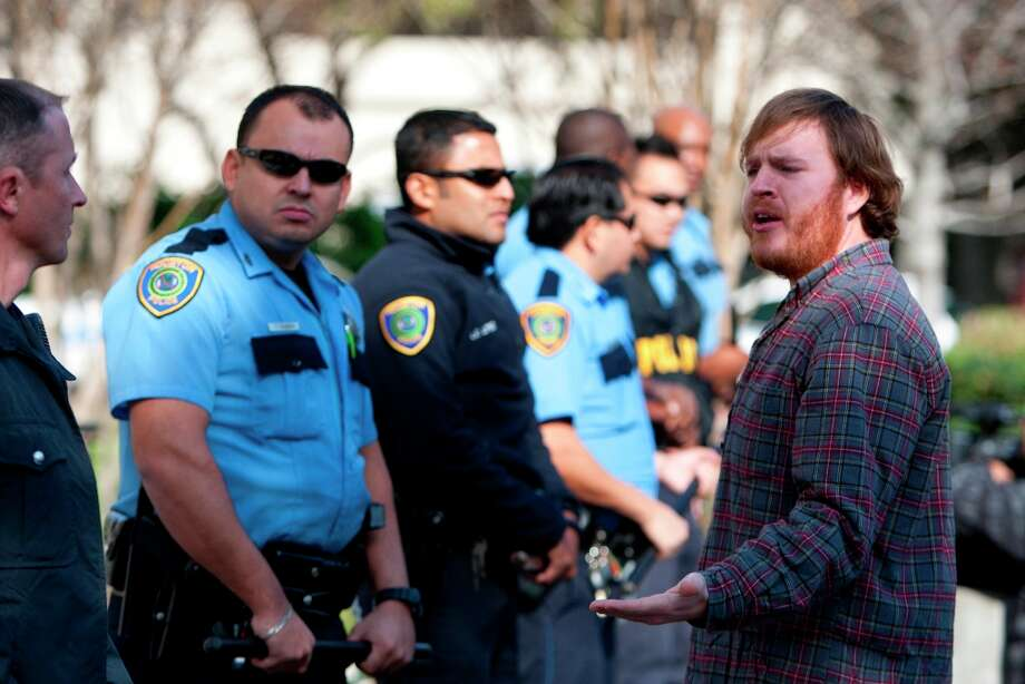 A member of the Tar Sands Blockade addresses police in front of a Houston building where a TransCanada office is located. Photo: Cody Duty / © 2012 Houston Chronicle