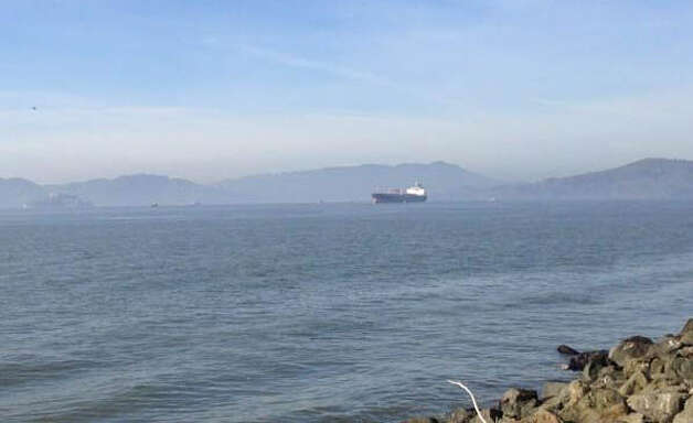 Oil tanker that struck tower of Bay Bridge just west of Treasure Island stopped out in bay. Photo: Ellen Huet / The Chronicle