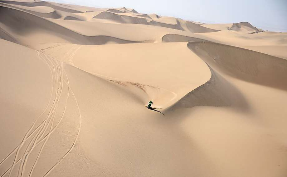 Dune tracker:KTM biker Pal Ullevalseter of Norway rides over the Sahara-like sands of Pisco, Peru, during the Stage 2 of the Dakar 2013. Photo: Franck Fife, AFP/Getty Images