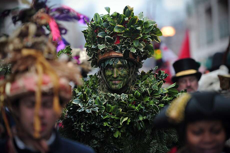 Happy holly days! The Green Man, a character from pagan myths and folklore, marches with other actors from the Bankside Mummers group during a Twelfth Night celebration in London.  Twelfth Night marks the end of the 12 days of winter festivities. Photo: Carl Court, AFP/Getty Images