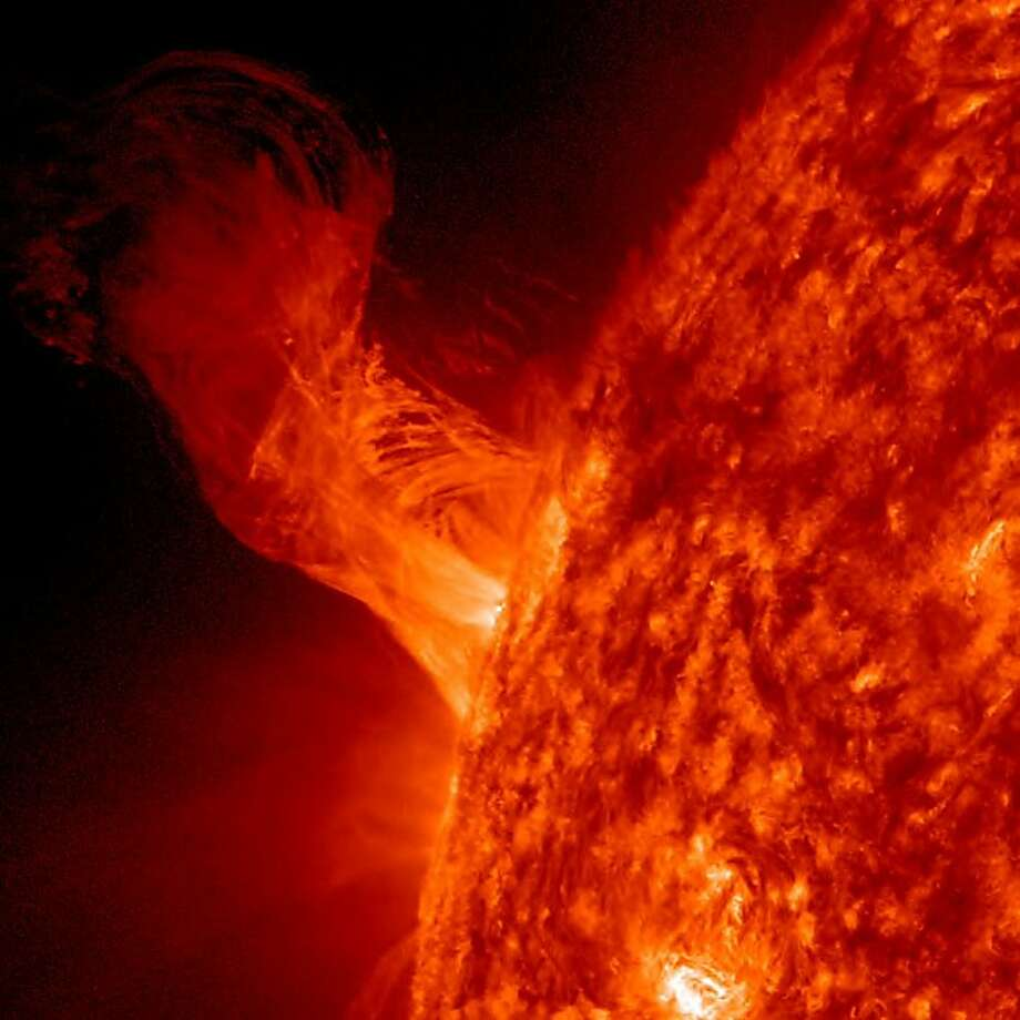 "Just your average plasma eruption:NASA calls this Dec. 31 solar flare, whose length (160,000 miles) is about 20 times the diameter of Earth, ""relatively minor."" Photo: Nasa, AFP/Getty Images"