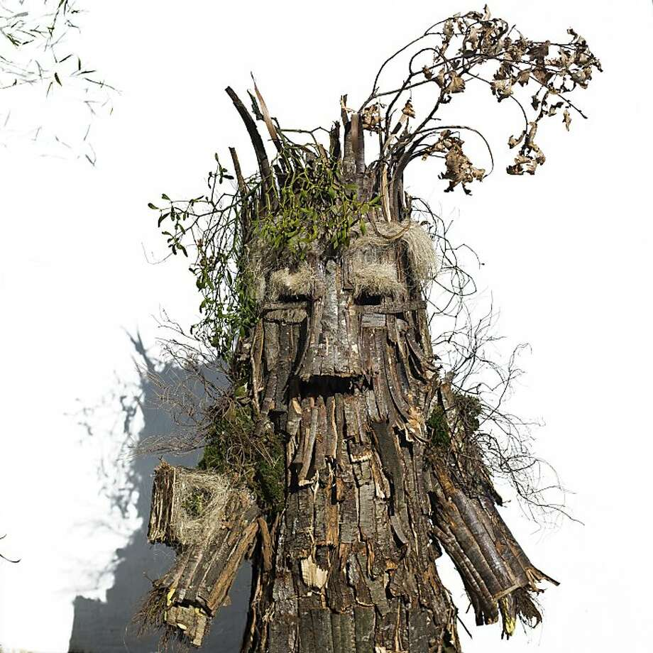 Tormented by Orcs, Saruman and Georgia-Pacific, Treebeard flees to northern Spain: A Trapajon, representing an entity of nature, takes part in the Vijanera Festival in Silio, Spain. Vijanera, a pre-Roman celebration symbolizing the triumph of good over evil, is the first carnival of the year in Europe. Photo: Daniel Ochoa De Olza, Associated Press