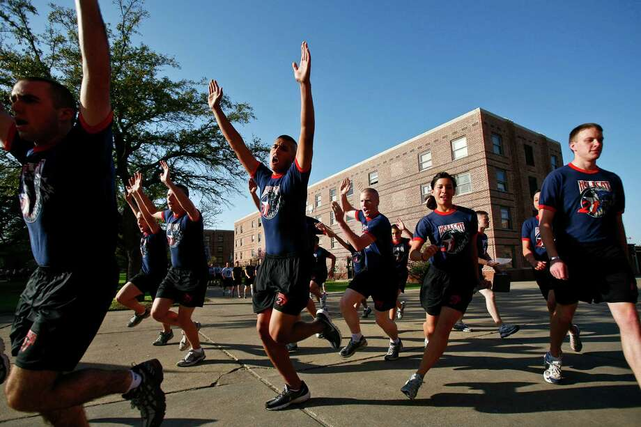 Texas A&M Corps cadets break from their formation and sprint into the dining hall on the campus of Texas A&M University. Photo: Michael Paulsen, Chronicle / Houston Chronicle