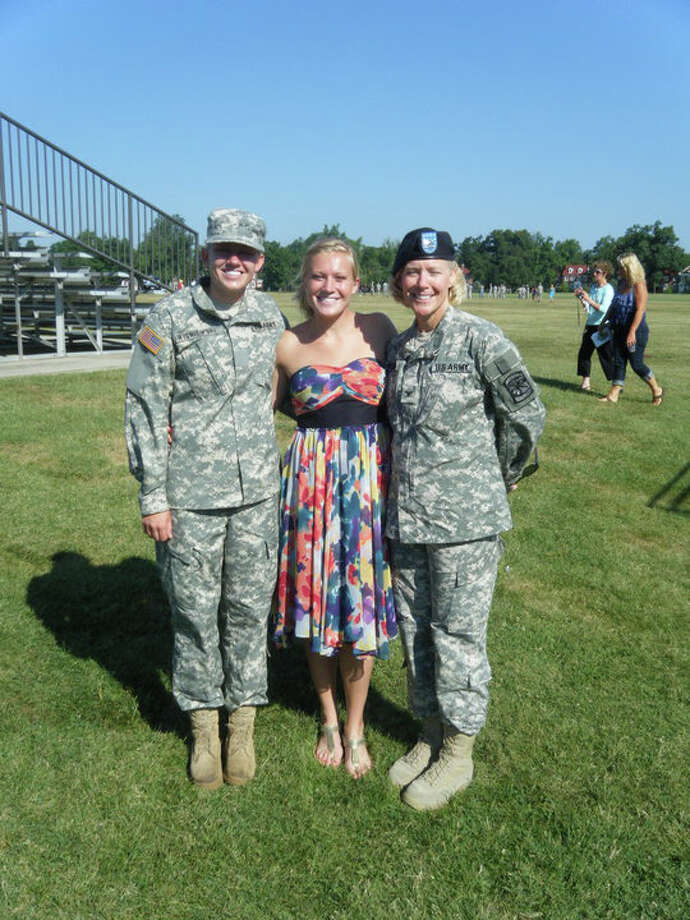 """Army ROTC Cadet Andrea Wisniewski (from left), Ammenda Wisniewski and Col. Sharon Wisniewski after an """"almost overwhelming"""" ceremony. Photo: Courtesy"""