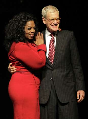 "FILE - This Nov. 26, 2012 file photo shows Ball State University alumnus David Letterman, right, host of CBS's ""Late Show,"" with Oprah Winfrey following an interview at Ball State University in Muncie, Ind. Letterman says he sees a psychiatrist once a week, part of his attempt to be the person he once believed he was. The late-night talk show host gave an extraordinary interview to Oprah Winfrey, where he talked about his feuds with her and Jay Leno and his own effort to make amends for the affairs that became public three years ago when a man tried to extort him.  (AP Photo/Michael Conroy, file) Photo: Michael Conroy"
