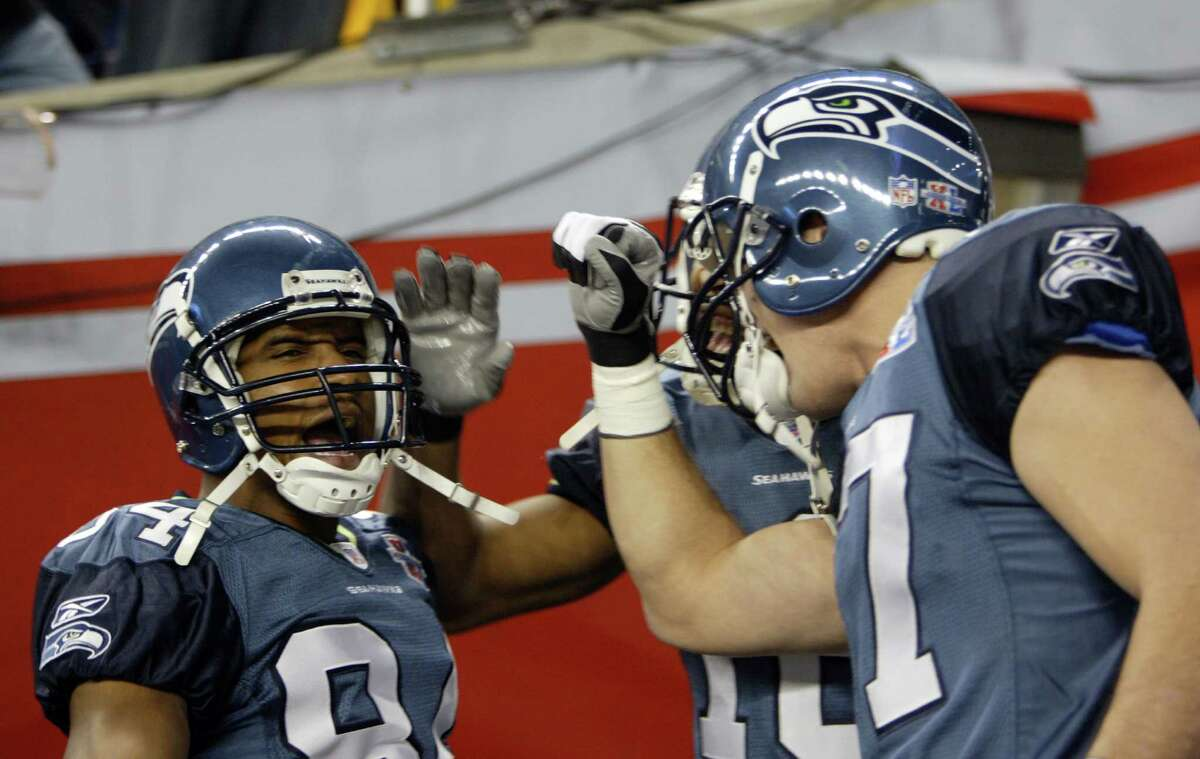 Receivers Bobby Engram (left) and Joe Jurevicius pump each other up before the game.