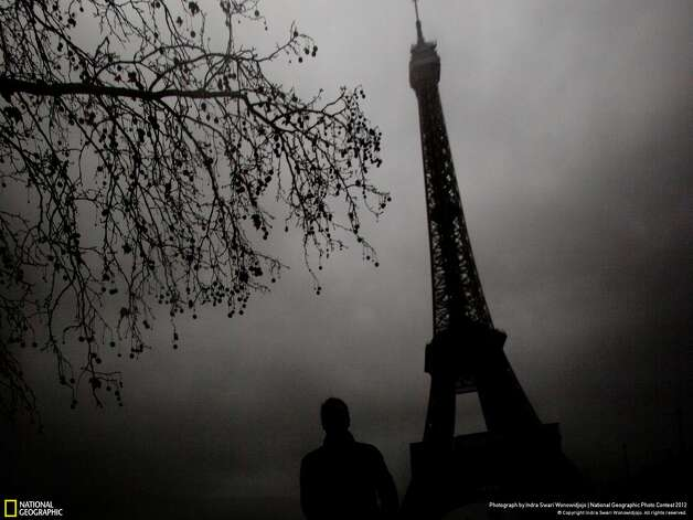 "Honorable mention: ""Eerie Eiffel""Photographer: Indra Swari WonowidjojoLocation: ParisWonowijojo: ""The winter gloomy day worked to my advantage to create this eerie feeling of the famous landmark Eiffel Tower."" Photo: Indra Swari Wonowidjojo / 2012 National Geographic Photography Contest"