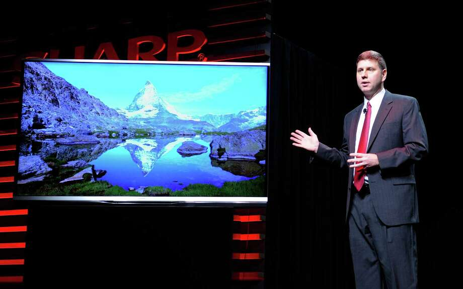 Sharp Electronics Vice President of Strategic Products Marketing Jim Sanduski unveils the Sharp Aquos Ultra HD television Monday at a press event at the Mandalay Bay Convention Center. Photo: David Becker, Getty Images / 2013 Getty Images