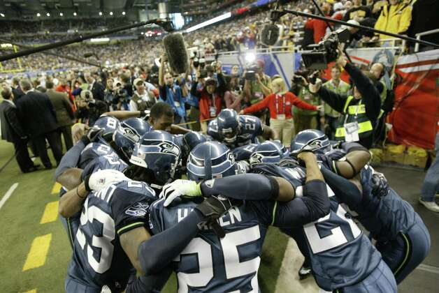 Seahawks players fire each other up before the game. Photo: Dan DeLong/seattlepi.com/MOHAI