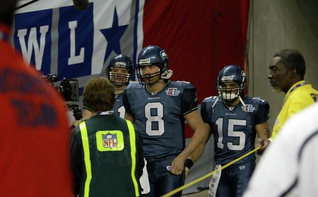 Quarterbacks Matt Hasselbeck (8) and Seneca Wallace (15) take the field. Photo: Dan DeLong/seattlepi.com File/MOHAI