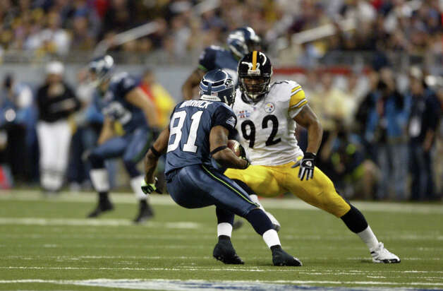 Pittsburgh's James Harrison stops Seattle's Peter Warrick for a loss of two yards on a first-quarter punt return. Photo: Dan DeLong/seattlepi.com File/MOHAI