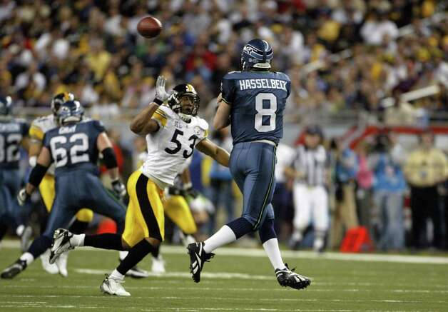 QB Matt Hasselbeck, who completed 26 of 49 passes for 273 yards and a touchdown, attempts a pass against the Steelers' Clark Haggans in the first quarter. Photo: Dan DeLong/seattlepi.com File/MOHAI