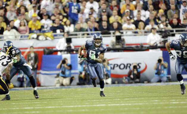 Peter Warrick returns a punt for the Seahawks. Warrick had four returns for 27 yards. Photo: Dan DeLong/seattlepi.com File/MOHAI