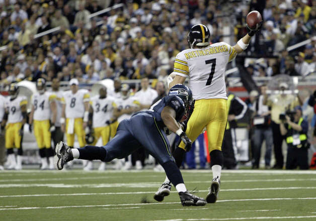 Steelers QB Ben Roethlisberger passes under pressure from an unidentified Seahawk. The second-year signal caller completed only nine of 21 passes for 123 yards, no touchdowns and two interceptions. Photo: By Dan DeLong/seattlepi.com/MOHAI