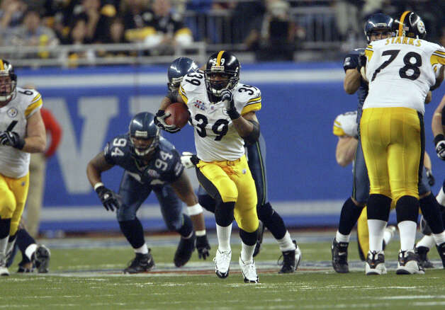 Pittsburgh's Willie Parker takes off on a 75-yard touchdown run in the third quarter that gave the Steelers a 14-3 lead. Photo: Dan Delong/seattlepi.com/MOHAI