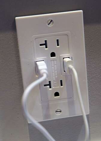 A Power 2U AC/USB outlet by Other World Computing is on display at a press event at the Mandalay Bay Convention Center for the 2013 International CES on January 6, 2013 in Las Vegas, Nevada. The 20 amp outlet will sell for USD 40 and will be available in February. CES, the world's largest annual consumer technology trade show, runs from January 8-11 and is expected to feature 3,100 exhibitors showing off their latest products and services to about 150,000 attendees. Photo: David Becker, Getty Images / 2013 Getty Images