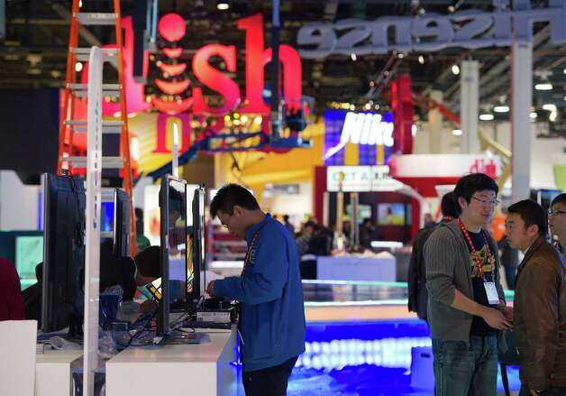 A worker sets up a television prior to the 2013 Consumer Electronic Show in Las Vegas, Nevada, U.S., on Monday, Jan. 7, 2013. The 2013 CES trade show, which runs until Jan. 11, is the world's largest annual innovation event that offers an array of entrepreneur focused exhibits, events and conference sessions for technology entrepreneurs. Photographer: David Paul Morris/Bloomberg Photo: David Paul Morris, Bloomberg / © 2013 Bloomberg Finance LP
