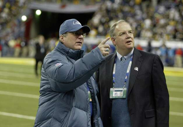 Seahawks owner Paul Allen (left) and general manager Tim Ruskell survey the crowd. Photo: Mike Urban/seattlepi.com/MOHAI / Seattle Post-Intelligencer